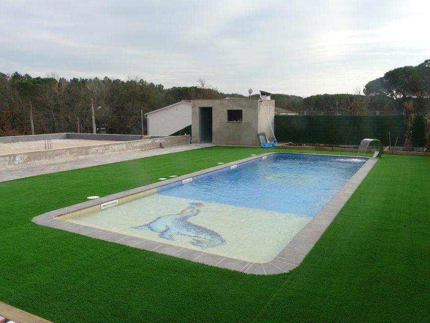 Piscines borrell dise o y construcci n de piscinas en la selva - Coste construccion piscina ...